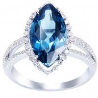 Sortija. Oro blanco 18K Diamantes: 0.35cts, talla brillante. Topacio London blue